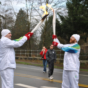 Olympic Torch Bearers Passing the Flame